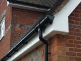 white plain soffits and fascia with black deep round guttering