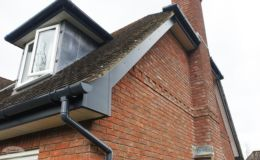 Grey fascias and guttering with white soffit