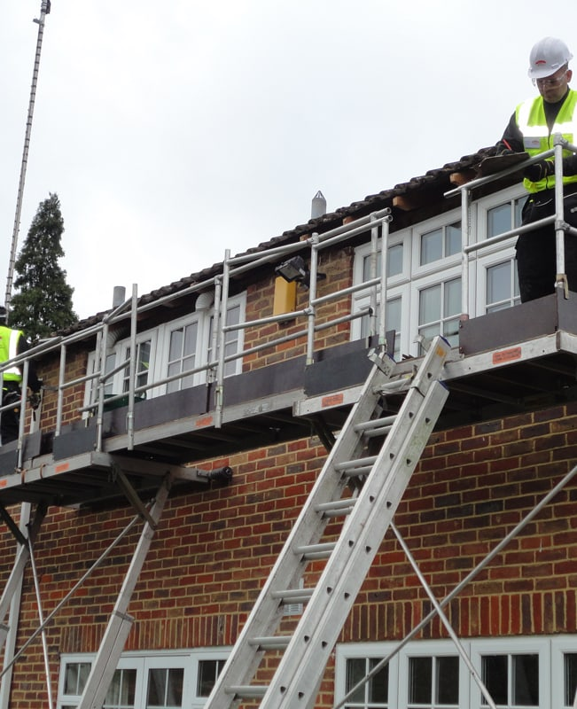 Removing old fascia using access equipment